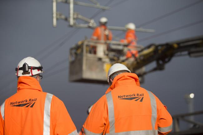 A general view of Network Rail engineering workers. Network Rail is among a group acting in partnership with Midlands Connect, which as submitted £3billion upgrade plans to the Government. (Credit: Network Rail/PA)