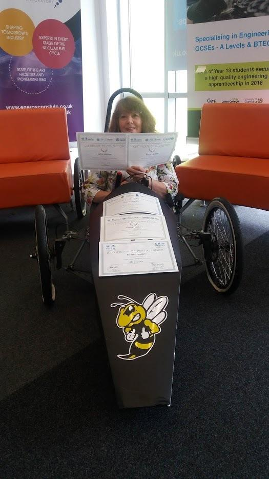 Fiona Heslam is in a battery powered car clutching her UN accreditation certificates.