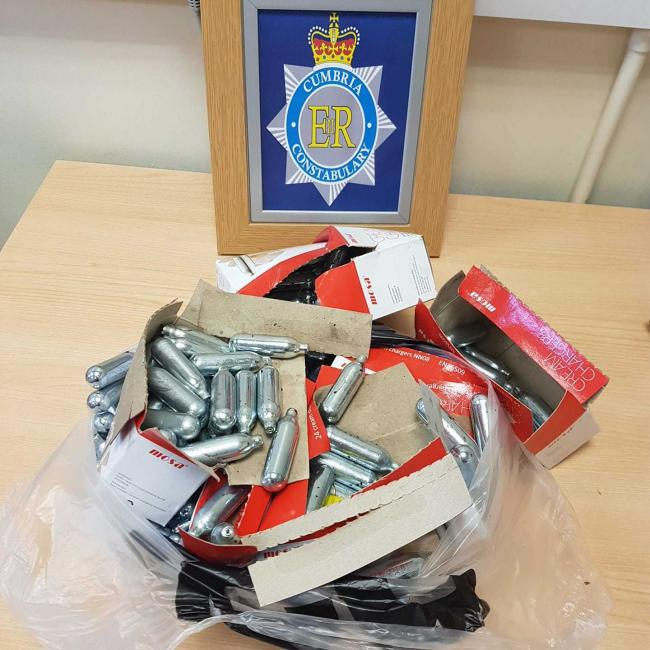Handed in: The empty canisters of nitrous oxide handed to Cumbria Police after being found in Bransty, Whitehaven