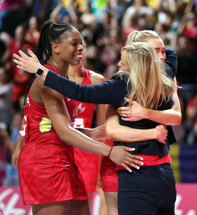 Close: Helen Housby and Eboni Usoro-Brown embrace departing England coach Tracey Neville (Photo: Press Association)