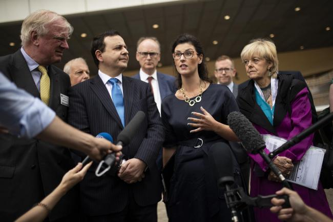 British lawmaker Layla Moran, second right, along with a cross-party delegation of British parliamentarians talk to journalists after meeting European Union chief Brexit negotiator Michel Barnier at the European Commission headquarters in Brussels, Friday