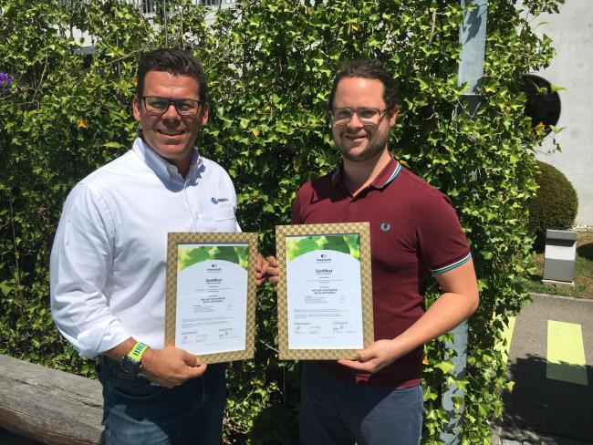 Innovia's Holger Eschenburg receiving the 'Made for Recycling' certification for Propafilm Strata from Interseroh's Julian Thielen.