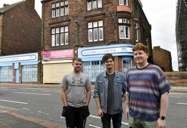 Regeneration and development of Victoria Viaduct in Carlisle. Plans have been submitted to develop the former Carlisle Bed Centre into a restaurant and boutique hotel. Behind the plan are (left to right) Matty Boak, Jack Lee and Daniel White: 7 August 201