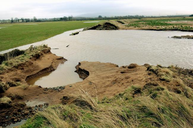12th January 2005 Flood defences breached at Aglionby by Steven Peel's Holme Gate Farm JONATHAN BECKER.