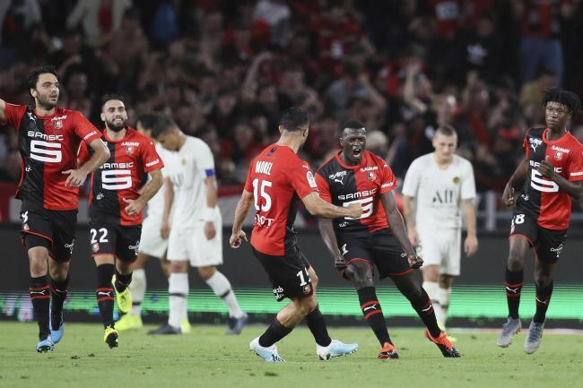 Rennes celebrated a hard-earned victory over Paris St Germain