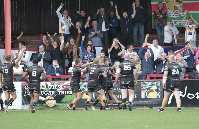 HAT-TRICK HERO: Sam Forrester celebrates one of his three tries with team-mates and fans                       Charlie Perry