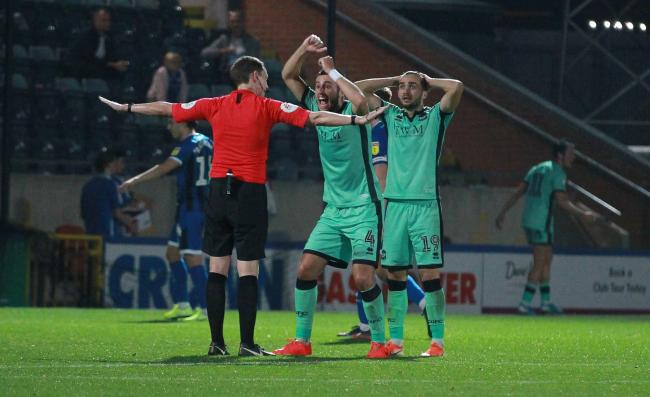 Ref Peter Wright dismisses strong Carlisle appeals for a second penalty at Rochdale (photo: Richard Parkes)