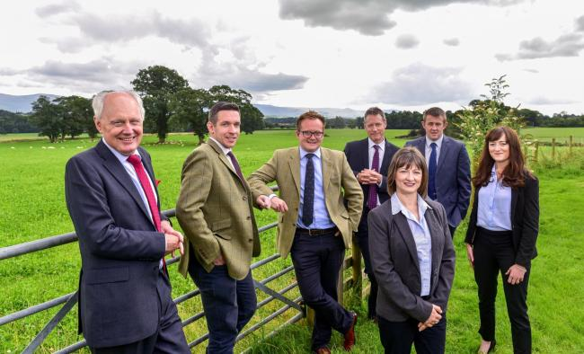 New identity: Colin Tomlinson, managing director, left, with the H&H Land & Estates operations team. The rebrand follows growth of the Carlisle-based business in the past few years