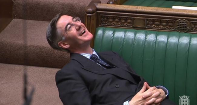 Take IT EASY: Jacob Rees-Mogg relaxes during a House of Commons Brexit debate this week
