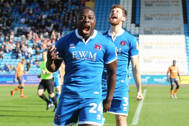 Celebrations: Olufela Olomola is overjoyed after scoring the only goal of the game in Carlisle United's 1-0 home win over Oldham (Photo: Barbara Abbott)