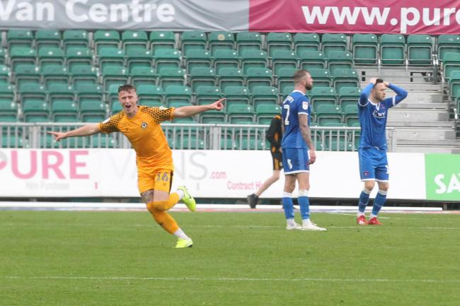 Late drama: George Nurse celebrates his stoppage-time goal which earned Newport County a 1-0 win over Carlisle United (Photo: Barbara Abbott)