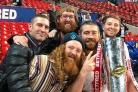 LOOK WHAT WE'VE WON: St Helens' Cumbrian star Kyle Amor holds the Super League Grand Final trophy, along with brother Blake, left, Sam Bailey, front, Chris Merner, back, and Ryan Dockerty