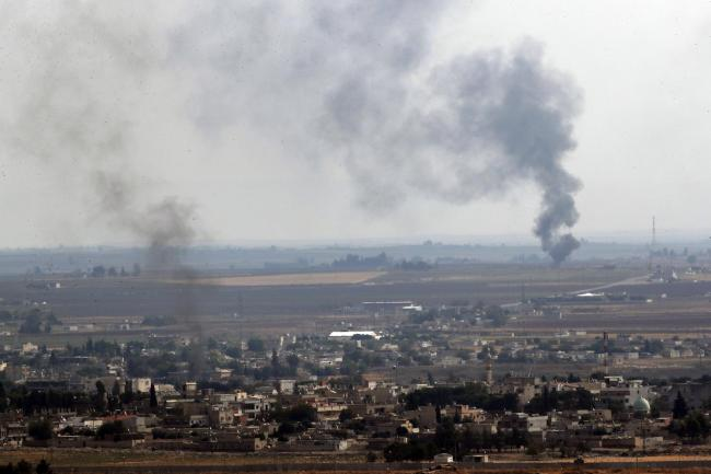 Smoke billows from fires in Ras al-Ayn, Syria