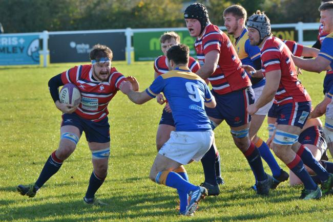 Hands-off: Carlisle's James Brocket takes on the Alnwick scrum-half (Photo: Bill Glendinning)