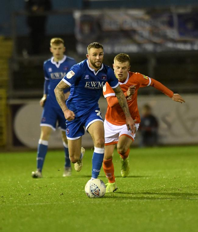 Injury blow: Carlisle defender Christie Elliott is expected to miss Saturday's game against Macclesfield and will see a specialist about his ankle injury next Tuesday (Photo: Stuart Walker)