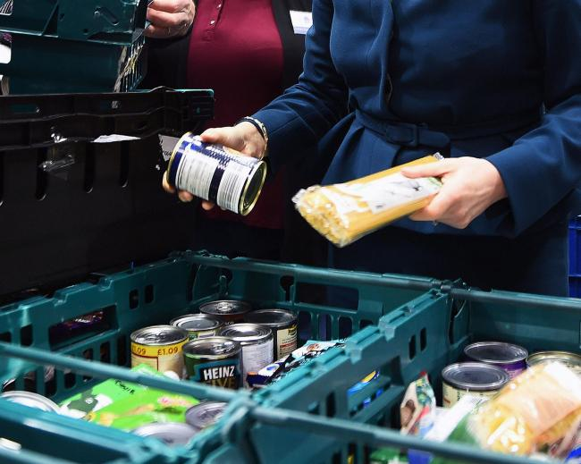 File photo dated 17/01/18 of goods at a food bank. The need for food banks increases in areas where Universal Credit has been in operation the longest, new research suggests..