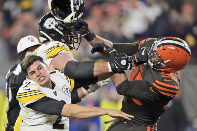 Cleveland Browns defensive end Myles Garrett (right) has been suspended indefinitely by the NFL for hitting Pittsburgh Steelers quarterback Mason Rudolph (left) with his own helmet