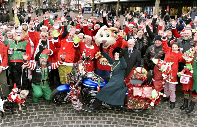 The Christmas motorbike run to fundraise for the News and Star Christmas Toy Appeal and Cash for Kids with CFM Mission Christmas. Bikers arrive at the Greenmarket in Carlisle city centre...Mayor of Carlisle Marilyn Bowman on one of the bikes with the bike