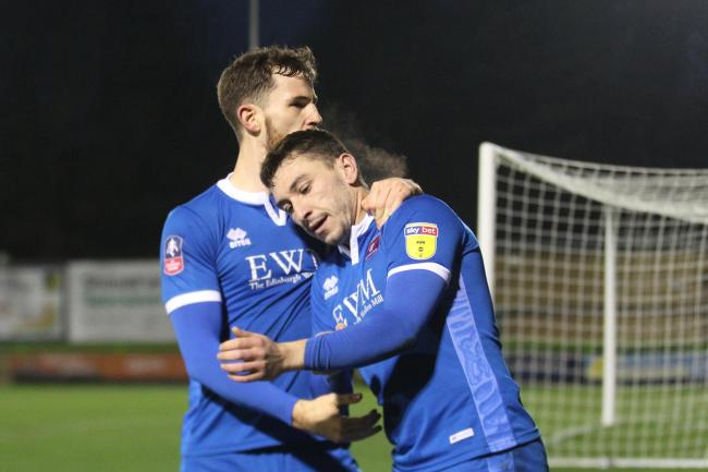 Celebrations: Nathan Thomas is embraced by Jack Iredale after scoring one of his two goals in Carlisle United's 2-2 FA Cup draw at Forest Green on Saturday (Photo: Barbara Abbott)