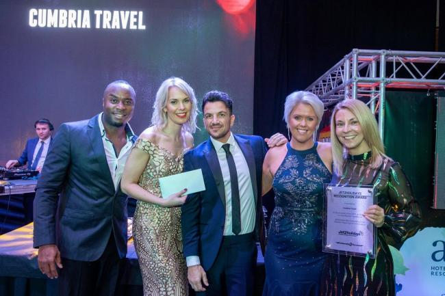 Winners: Cumbria Travel staff with Peter Andre