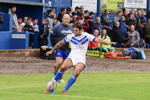 Carl Forber attempting a kick for Workington Town. Picture: Gary McKeating