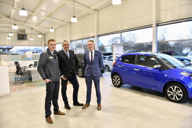Refurbished: Harry, Greg and Jack Telford at the revamped Telford's Citroen and DS Automobile showroom