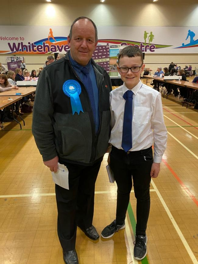 HELPING HAND: Councillor Andy Pratt and son Sam at the Copeland election count