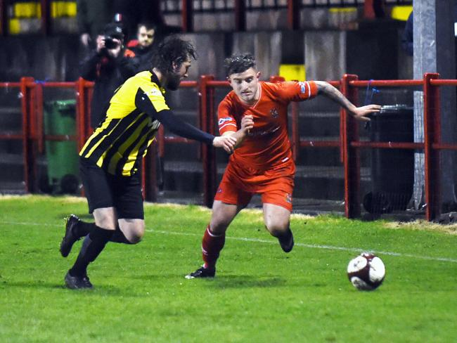 Dav Symington looks to beat his man against Prescot Cables, pic Mike Mckenzie