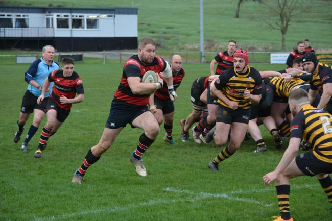 Bursting THROUGH: Aspatria's Matthew Atkinson breaks at speed during win over Leigh                BARNEY CLEGG