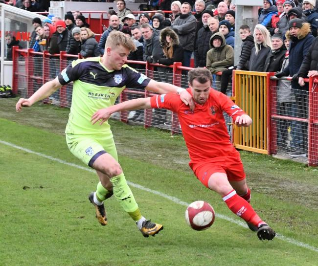 Workington Reds v Ossett: Brad Hubbold makes space for his  cross (Ben Challis)