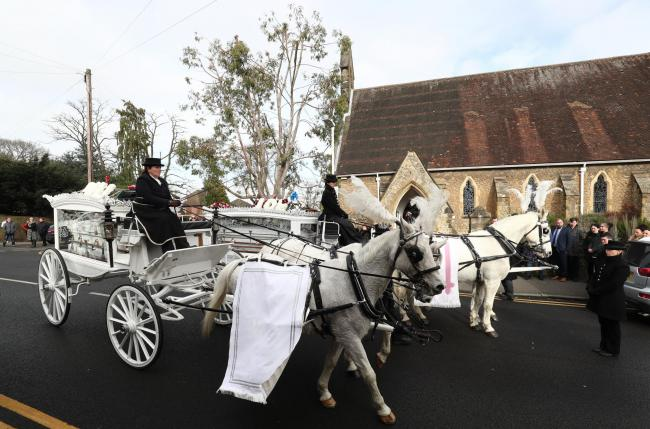 The cortege of horse-drawn carriages carrying the coffins of Billy and Joe Smith arrive at St John the Baptist Church, Sevenoaks