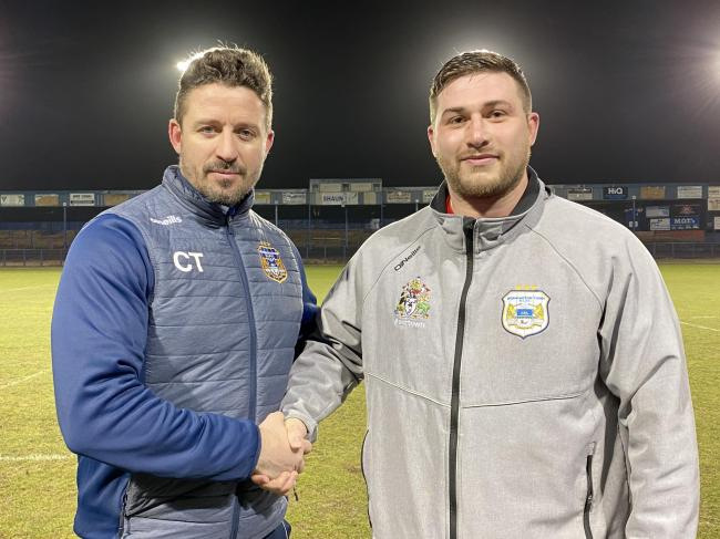 n Workington Town head coach Chris Thorman with new signing Adam Ramsden			        GARY MCKEATING