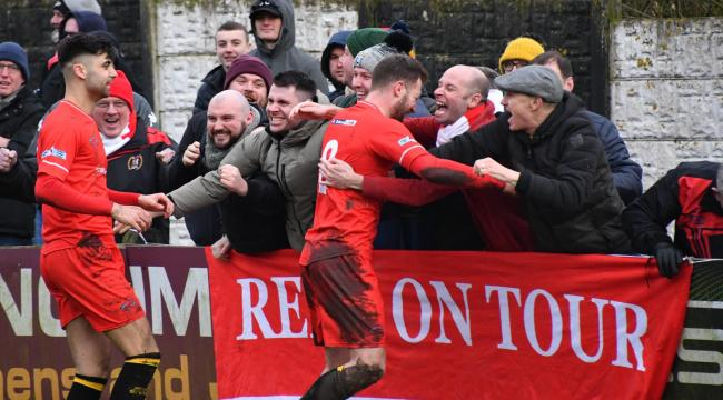Brad Carroll celebrates his second goal of three at Kendal with the vocal away following. Picture: Ben Challis