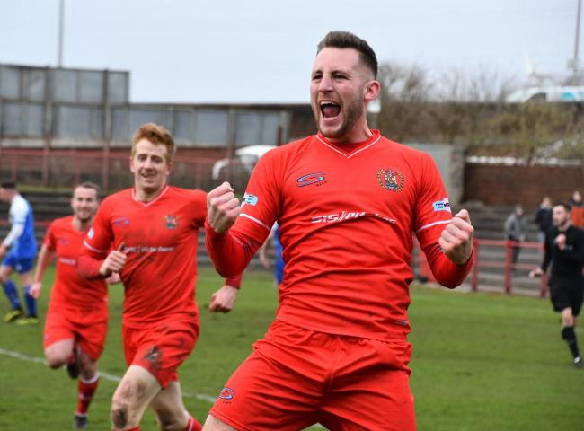 n Brad Carroll celebrates his first-half goal against Clitheroe which helped send Workington Reds seven points clear at the top of the league			 BEN CHALLIS