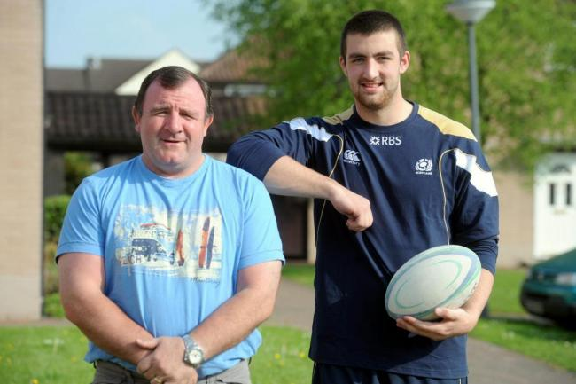 Memories: Gary Graham, right, with dad George, as Gary prepared to represent Scotland Under-20s in 2012 Junior World Cup