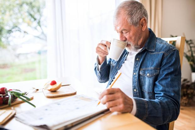 A generic stock photo of an older man doing crosswords at home. See PA Feature TOPICAL Wellbeing Older Relatives. Picture credit should read: iStock/PA. WARNING: This picture must only be used to accompany PA Feature TOPICAL Wellbeing Older Relatives.