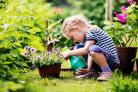 Undated Handout Photo of a child in a garden with flowers. See PA Feature GARDENING Advice Nature. Picture credit should read: iStock/PA. WARNING: This picture must only be used to accompany PA Feature GARDENING Advice Nature..