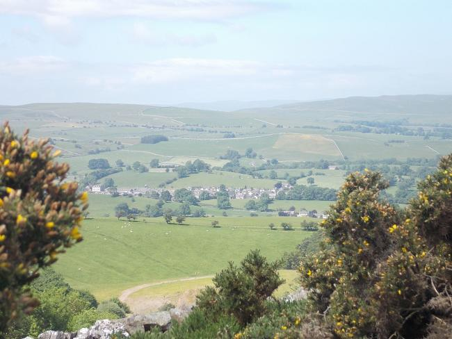 Looking down at Kirkby Stephen from the climb up to Nine Standards Rigg.