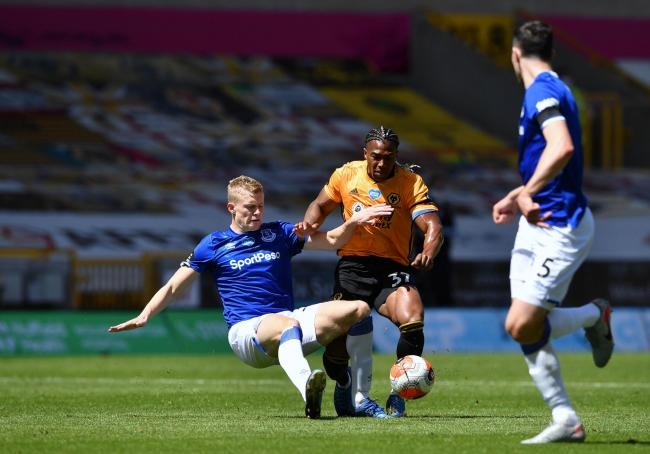 BATTLE: Everton's Jarrad Branthwaite (left) and Wolves' Adama Traore battle for the ball	       Picture: PA Wire