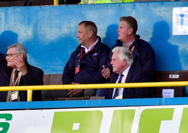 Philip Day, back right, in the directors' seats at United's recent game against Fleetwood (photo: Stuart Walker)