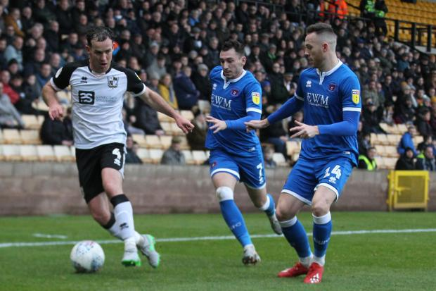 News and Star: Joyce in action against Carlisle for Port Vale last season (photo: Barbara Abbott)