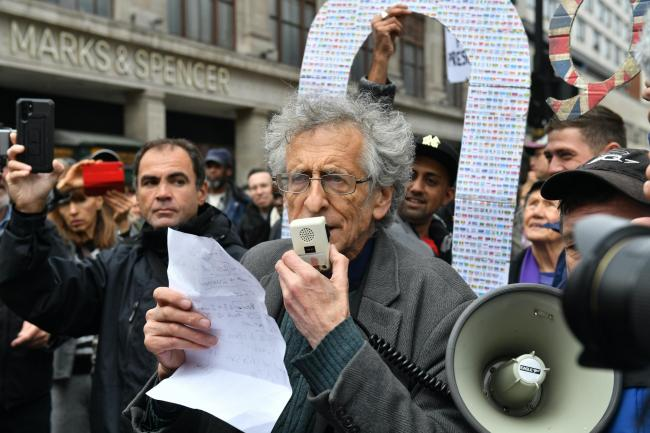 The brother of former Labour leader Jeremy Corbyn, Piers Corbyn, speaks to protesters during an anti-lockdown rally on Oxford Street, London (Dominic Llipinski/PA)