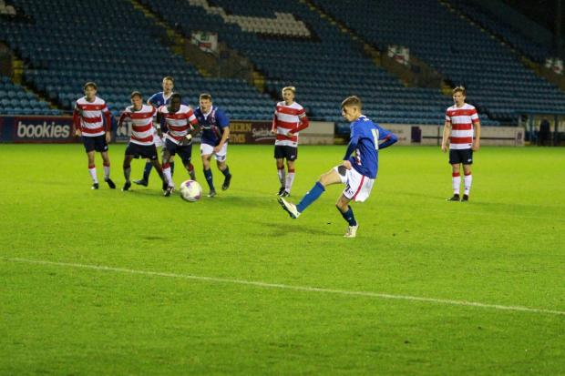 News and Star: Taylor scores a winning penalty for Carlisle against Doncaster in the FA Youth Cup in the 2015/16 campaign