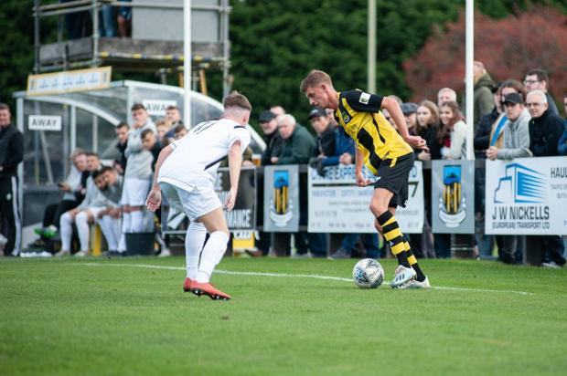 News and Star: Taylor, right, in action for Hebburn Town in Northern League Division One