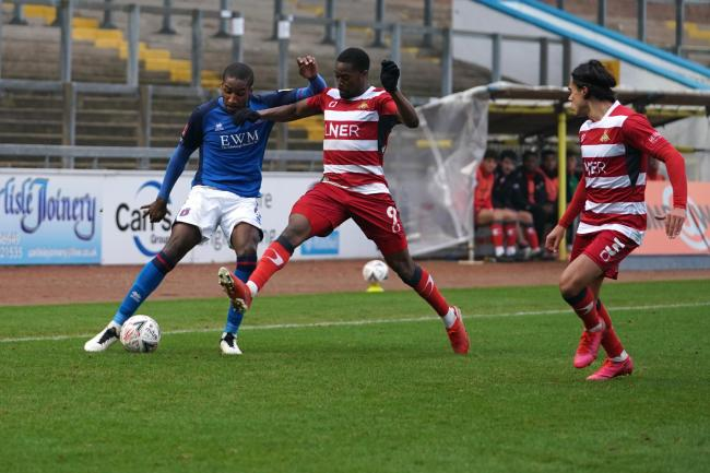 Contest: United's Aaron Hayden tries to make headway against Doncaster Rovers (photo: Barbara Abbott0