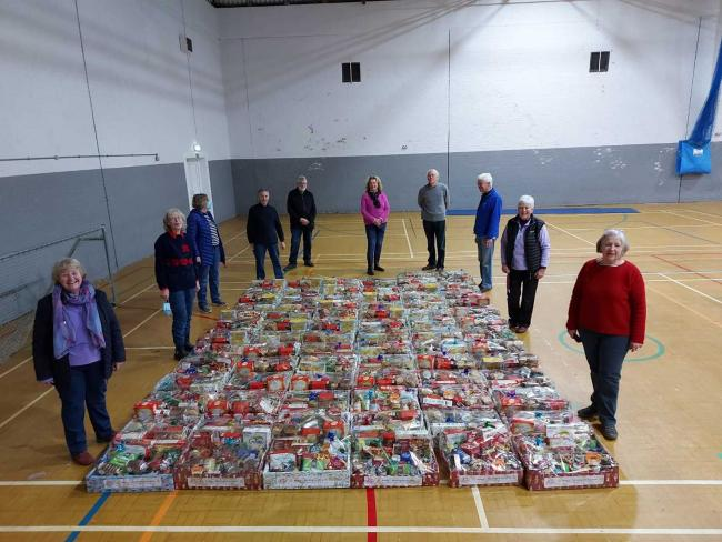Members of Workington Derwent Rotary and Workington Derwent Inner Wheel have packed and distributed 150 Christmas hampers