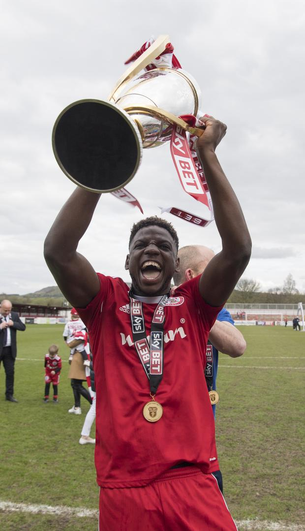 News and Star: Zanzala lifts the League Two title trophy with Accrington Stanley in 2018 (photo: PA)