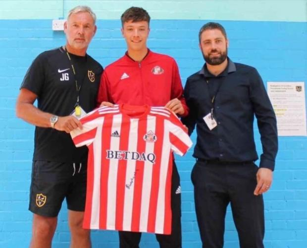 News and Star: Sunderland's Ryan Wombwell, centre, who came through the Park View Academy system, pictured with the academy's John Gamble, left, and Lewis Pendleton
