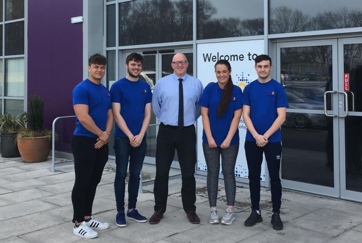 Allister Green, The Cumberland's product development manager with apprentices from Gen2