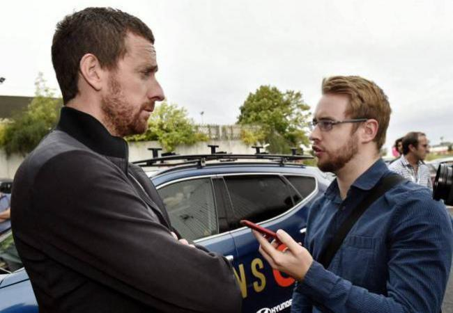 Reporter Jonny Irving, right, with cyclist Bradley Wiggins